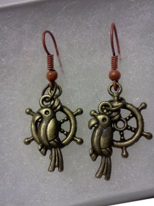 New never worn, hook style parrot with ship wheel earrings, made by Me