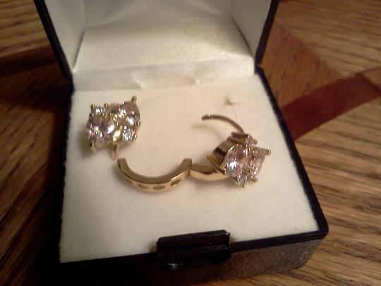 Other New without tags, cute clip closed pierced gold tone earring with pink stones