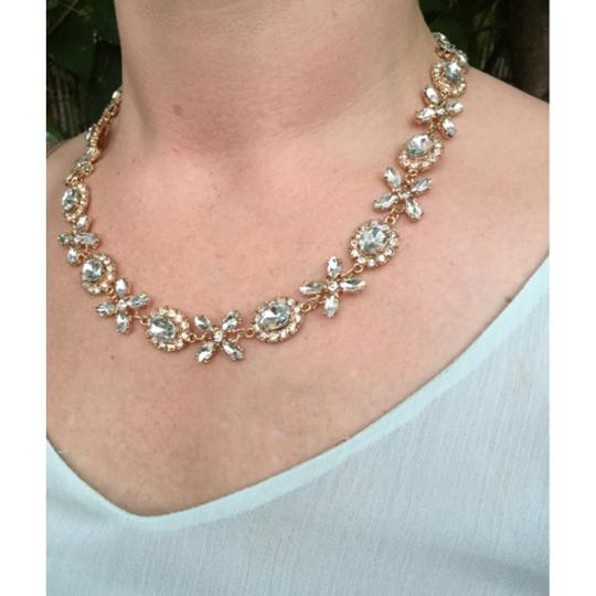 Preload https://item1.tradesy.com/images/clear-crown-floret-jewel-xoxo-elegant-fashion-statement-bridesmaid-new-necklace-4032760-0-0.jpg?width=440&height=440