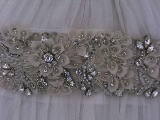 Preload https://item1.tradesy.com/images/ivory-intricate-floral-with-crystals-and-beading-sash-403650-0-0.jpg?width=440&height=440