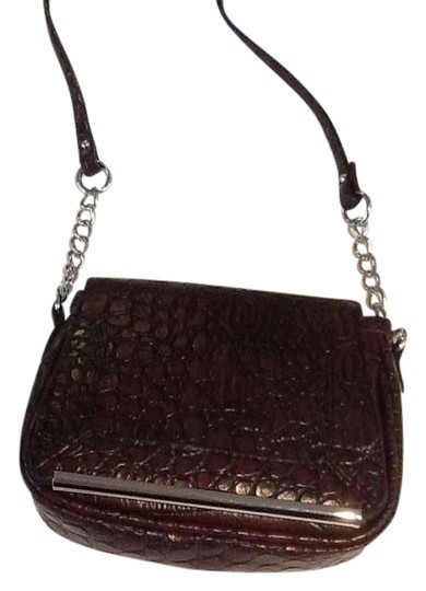 Preload https://item4.tradesy.com/images/charming-charlie-snake-brown-plastic-satchel-403858-0-0.jpg?width=440&height=440