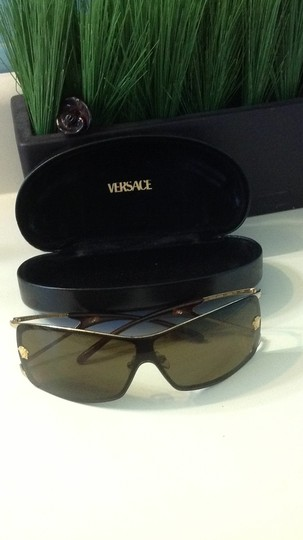 Preload https://item3.tradesy.com/images/versace-brown-sunglasses-40432-0-0.jpg?width=440&height=440
