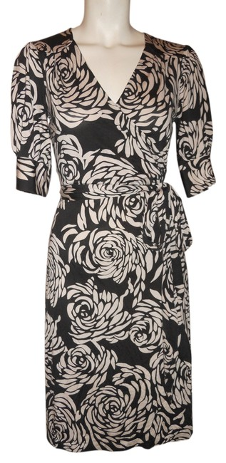 Preload https://item1.tradesy.com/images/banana-republic-black-and-cream-knit-mock-wrap-knee-length-workoffice-dress-size-4-s-4050760-0-0.jpg?width=400&height=650