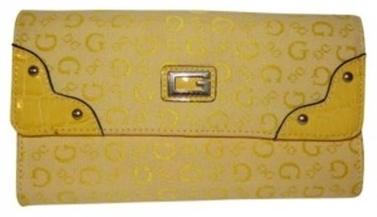 Preload https://item1.tradesy.com/images/guess-yellow-signature-wallet-40540-0-0.jpg?width=440&height=440