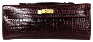 Hermès Plum Niloticus Crocodile Kelly Cut Pochette Borduex Clutch