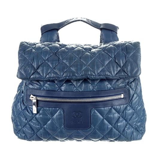 Preload https://item2.tradesy.com/images/chanel-backpack-cocoon-coco-cc-logo-quilted-leather-blue-nylon-backpack-4085116-0-1.jpg?width=440&height=440
