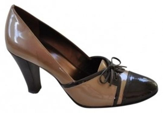 Preload https://item1.tradesy.com/images/ak-anne-klein-tan-with-brown-accents-patent-leather-dress-pumps-size-us-7-regular-m-b-40855-0-0.jpg?width=440&height=440