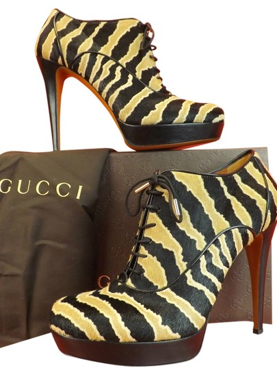 Preload https://item4.tradesy.com/images/gucci-blackcaramel-betty-zebra-print-hair-lace-up-platform-ankle-8-bootsbooties-size-eu-38-approx-us-4086178-0-0.jpg?width=440&height=440