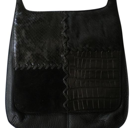 Preload https://item3.tradesy.com/images/fossil-vintage-black-leatherblack-cow-hair-cross-body-bag-4089622-0-0.jpg?width=440&height=440
