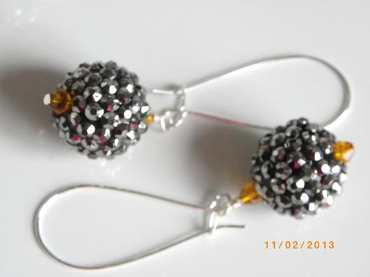 Other dark grey disco ball orange crystal earrings