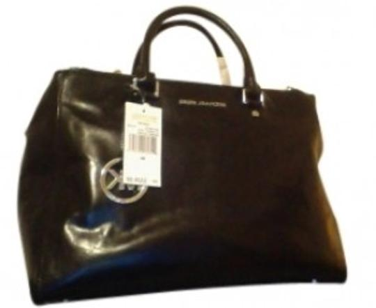 Preload https://item3.tradesy.com/images/michael-kors-large-dressy-purse-black-leather-tote-41067-0-0.jpg?width=440&height=440