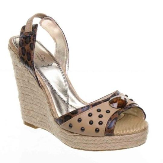 Preload https://item2.tradesy.com/images/baby-phat-addison-womens-tan-high-heels-platform-sandal-wedge-shoes-bd112371-75-4111126-0-0.jpg?width=440&height=440