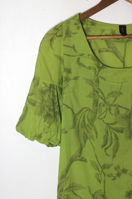 Mimo short dress Green Babydoll Floral Print Vintage Inspired Puffed Sleeve Bell Sleeve on Tradesy