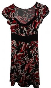 Tempted short dress Black, red and white flower print & on Tradesy
