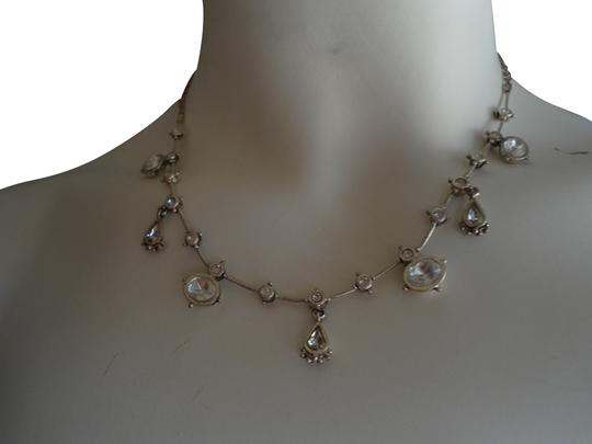Preload https://item3.tradesy.com/images/anne-klein-silvertone-and-crystals-go-to-glamour-necklace-412332-0-0.jpg?width=440&height=440