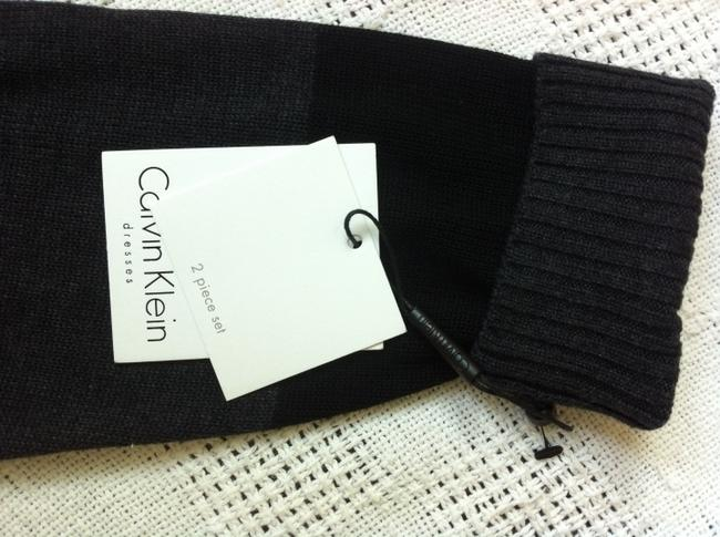 Calvin Klein 2 Piece Sweater (1) Sleeveless That Can Be Alone (1) Long Sleeve Button Down With 2 Front Pockets Comes With Extra & Dress