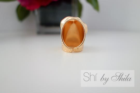 "Other Adjustable ""Telesto"" Statement Ring"