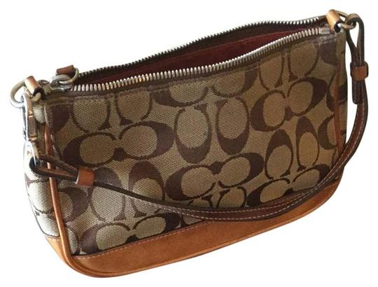 Preload https://item3.tradesy.com/images/coach-brown-canvas-and-leather-wristlet-4144837-0-0.jpg?width=440&height=440