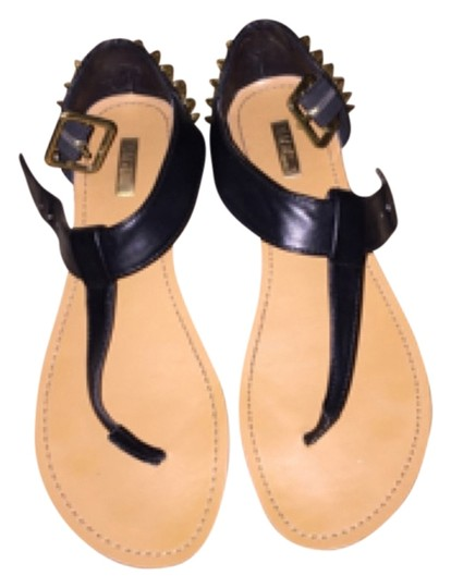 Preload https://item1.tradesy.com/images/wild-pair-black-and-gold-sandals-4158565-0-0.jpg?width=440&height=440