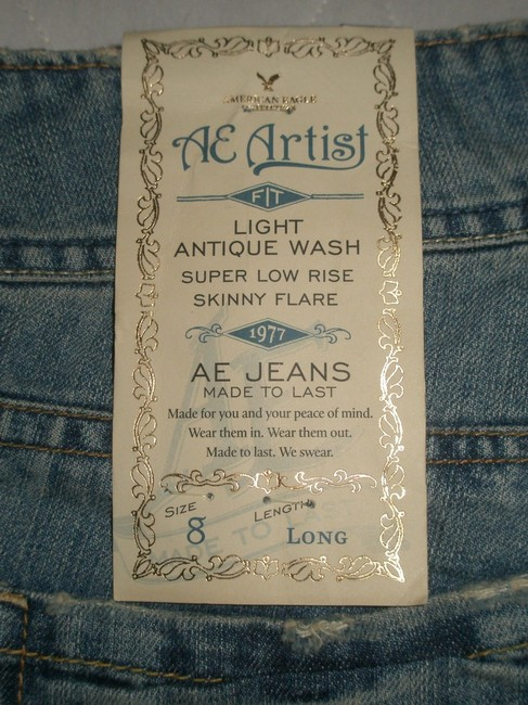 American Eagle Outfitters Super Low Rise * Skinny Opening * 5 Pocket Style * Zip Fly * Light Antique Wash * Machine Washable * Cotton Flare Leg Jeans-Light Wash