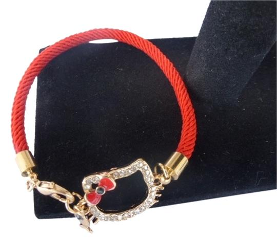 Hello Kitty HELLO KITTY WITH GEMSTONES ON RED CORD & FISH CHARM