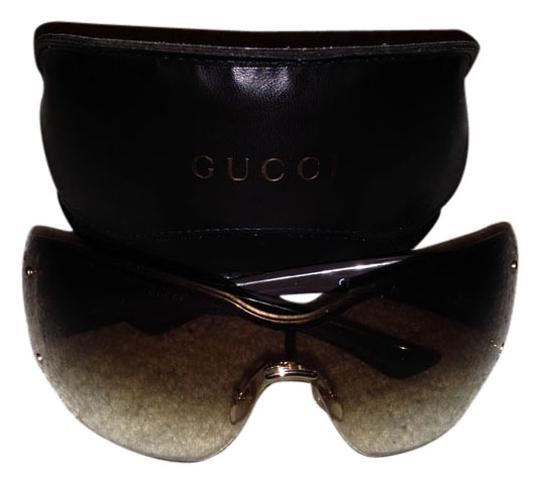 Preload https://item4.tradesy.com/images/gucci-brown-oversized-rimless-sunglasses-4191073-0-0.jpg?width=440&height=440