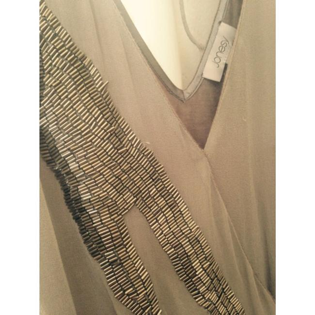 Joney grey sequined drop waist top. Size large. Glass silver and glass beaded front. Elastic drop waist. Chifon layer in front anf heather grey stretchy jersey throughout. Pull over. Top Grey & Silver