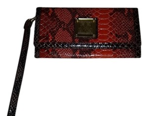 Miss Tina Orange and black Clutch