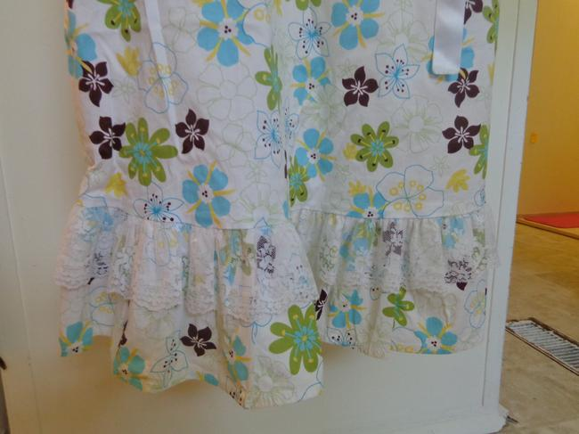 Unyx short dress white with aqua,green and brown flowers Summer on Tradesy