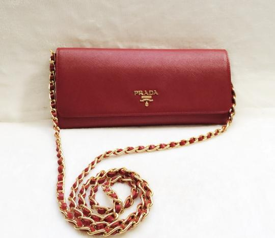 Preload https://item4.tradesy.com/images/prada-red-fuoco-saffiano-woc-wallet-4261483-0-0.jpg?width=440&height=440