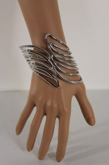 Preload https://item4.tradesy.com/images/women-shinny-silver-metal-angel-wing-coutout-cuff-fashion-bracelet-geometric-4283683-0-0.jpg?width=440&height=440