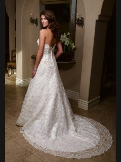 Preload https://item5.tradesy.com/images/casablanca-ivory-lace-1918-traditional-wedding-dress-size-petite-6-s-42844-0-0.jpg?width=440&height=440