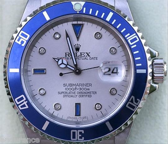 Preload https://item2.tradesy.com/images/rolex-rolex-submariner-16610-mens-watch-diamond-and-sapphire-dial-with-blue-bezel-4347271-0-0.jpg?width=440&height=440