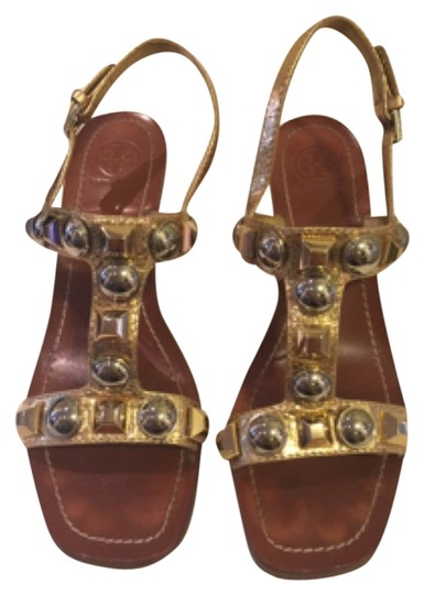 Preload https://item1.tradesy.com/images/tory-burch-gold-sandals-size-us-75-regular-m-b-4377340-0-0.jpg?width=440&height=440
