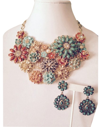 Preload https://img-static.tradesy.com/item/4390639/turquoiseorangecrystalgold-2-piece-set-faceted-stone-earrings-necklace-0-0-540-540.jpg