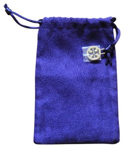 Tory Burch Tory Burch cloth jewelry bag with logo charm.