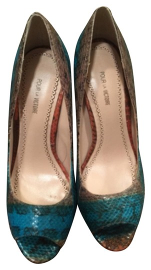 Preload https://item3.tradesy.com/images/pour-la-victoire-teal-and-brown-angelie-snakeskin-platforms-size-us-7-regular-m-b-4422412-0-0.jpg?width=440&height=440