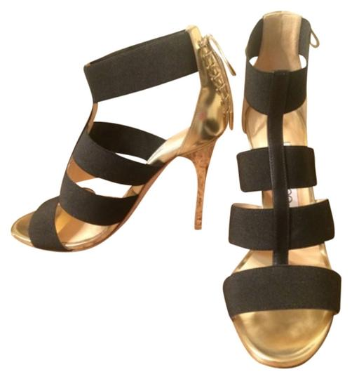Preload https://item3.tradesy.com/images/jimmy-choo-black-and-gold-sexy-heels-formal-shoes-size-us-75-regular-m-b-4426057-0-0.jpg?width=440&height=440