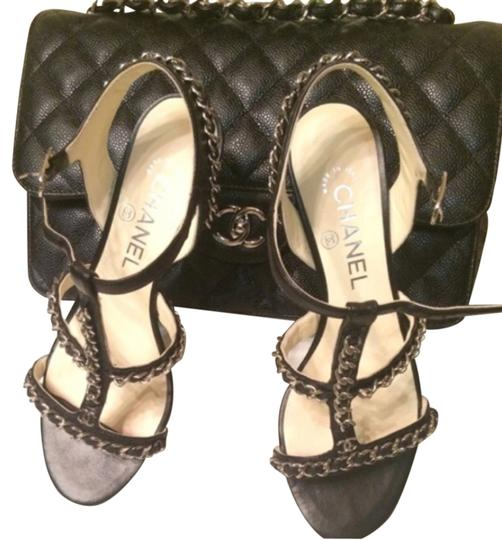 Preload https://item3.tradesy.com/images/chanel-black-and-silver-chain-formal-shoes-size-us-75-regular-m-b-4426582-0-0.jpg?width=440&height=440