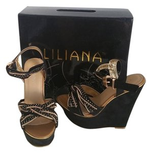 Liliana Black and gold Wedges