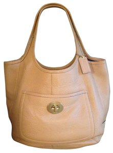 Coach Pebbled Leather Turnlock Tote in Tan