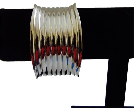 Preload https://item1.tradesy.com/images/stainless-steel-stately-big-and-bold-ribbed-design-bangle-size-7-12-bracelet-4507195-0-0.jpg?width=440&height=440