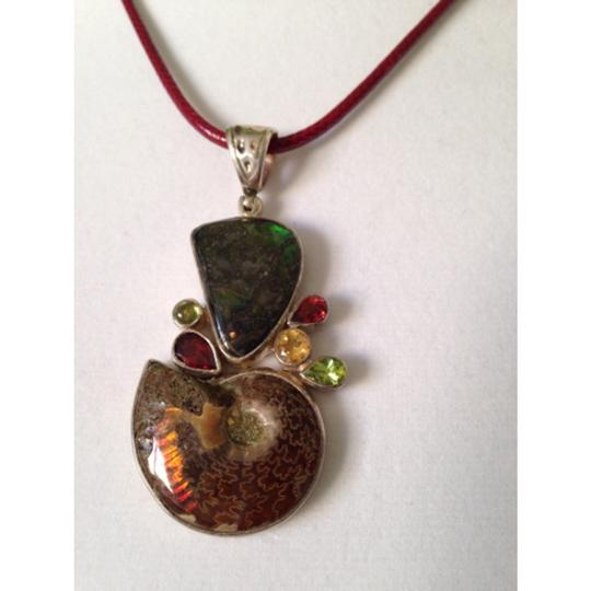 My Closet- Embellished by Leecia Embellished by Leecia Ammolite Fossil Pendant