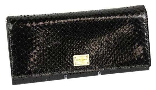 Preload https://item5.tradesy.com/images/dolce-and-gabbana-black-dolce-and-gabbana-python-continetnal-leather-wallet-4512469-0-0.jpg?width=440&height=440