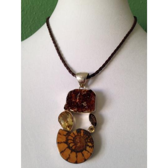 My Closet- Embellished by Leecia Embellished by Leecia Ammonite Fossil Pendant Only! Matching Pieces Sold Seperately