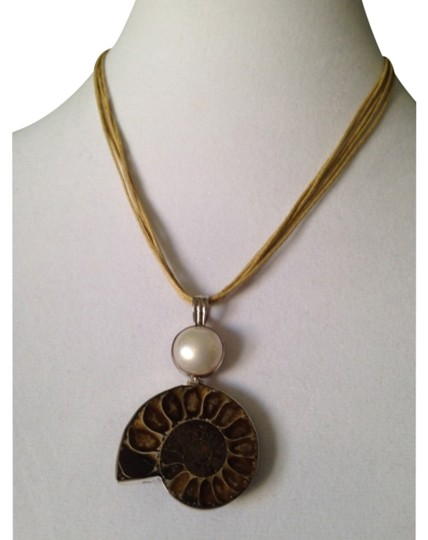 Preload https://item4.tradesy.com/images/brownwhitesilver-ammonite-pendant-only-matching-pieces-sold-seperately-necklace-4516603-0-0.jpg?width=440&height=440