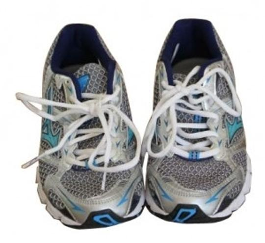 Preload https://img-static.tradesy.com/item/4532/mizuno-silver-and-blue-women-s-wave-rider-13-running-sneakers-size-us-65-0-0-540-540.jpg