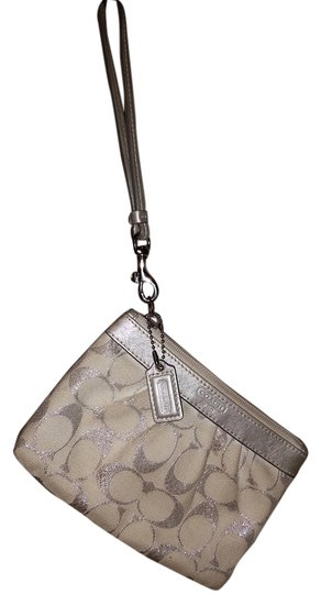 Preload https://item5.tradesy.com/images/coach-silver-and-ivory-canvas-wristlet-4543444-0-0.jpg?width=440&height=440