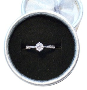 Brand New.925 Sterling Silver (marked) Engagement Style Ring With CZ. Stones