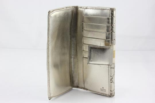 Gucci * Gucci GG Embossed Metallic Flap Over Wallet - Silver